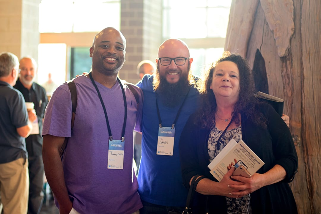 Three GLS18 attendees smile while enjoying the conference.
